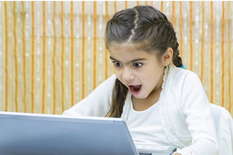 shutterstock_217542319-Child-with-laptop